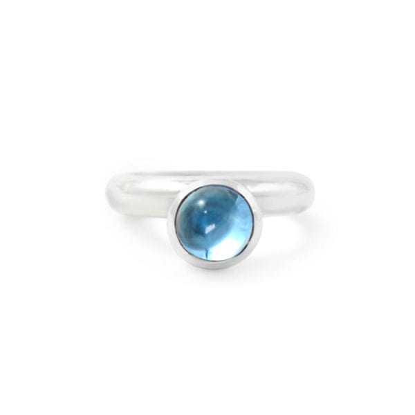 Blue topaz cabochon ring in sterling silver