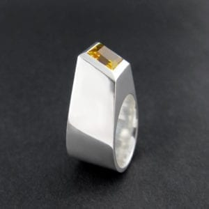 Statement sterling silver and cocktail ring with a princess cut citrine