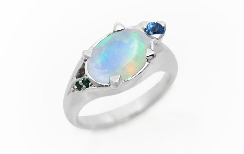 Turtle ring in white gold, opal, emeralds and topaz