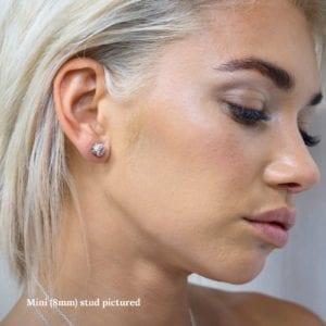 Mini 3D printed Negative/Positive stud earrings being worn