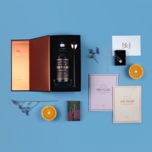 Anniversary gift set with Four Pillars Gin, rose gold and sterling silver necklace and two cocktail books