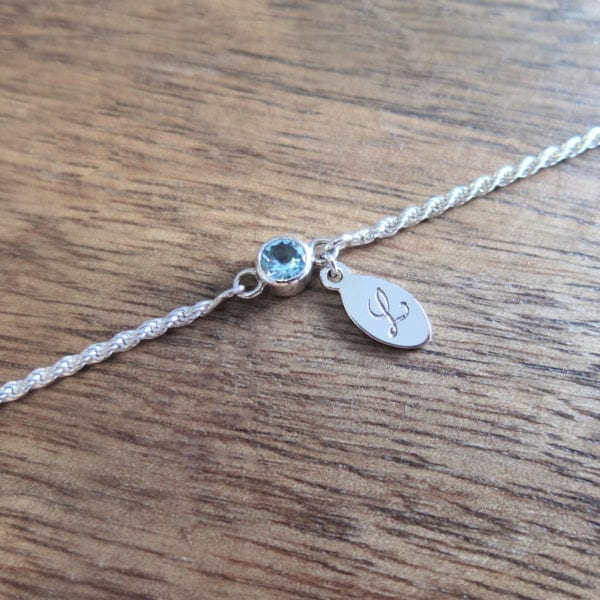 Personalised bracelet with engraved letter tag