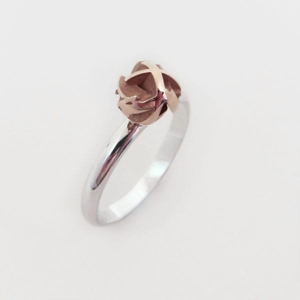 Rose gold geometric ring, created through a 3D printing process