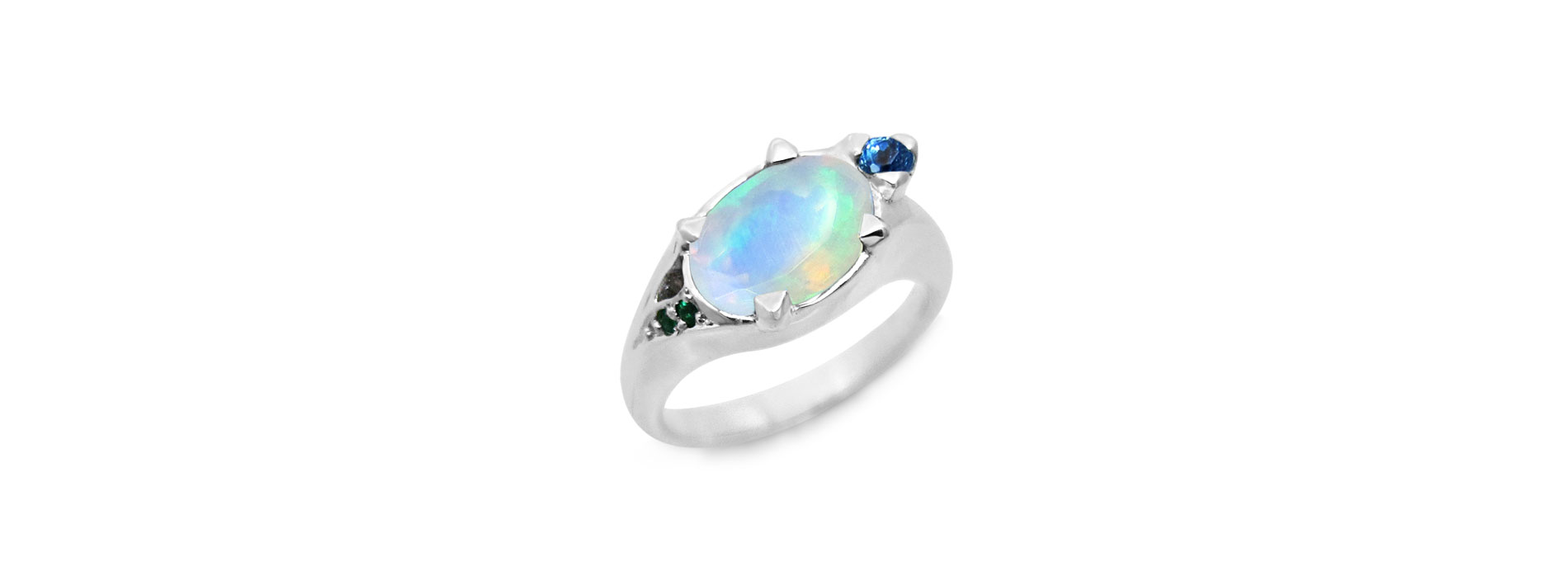 White gold turtle ring with opal, emeralds and blue topaz