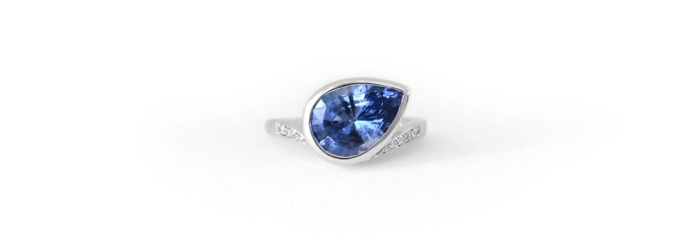 Untraditional engagement ring with Ceylon sapphire, white gold and diamonds
