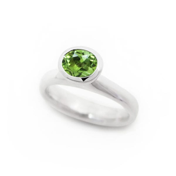 Oval peridot ring with bright green gemstone