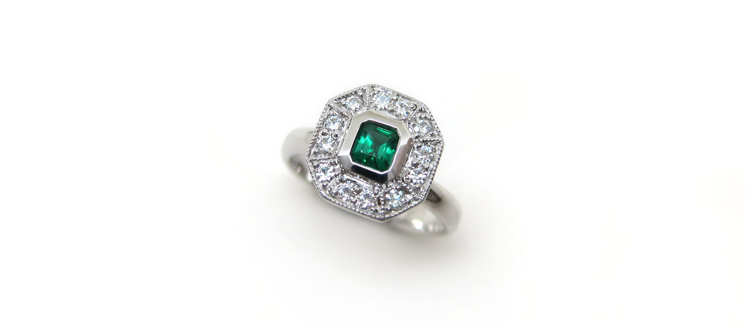 Vintage-style emerald, diamond and white gold ring