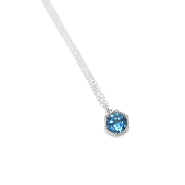 Blue topaz hexagon necklace in sterling silver