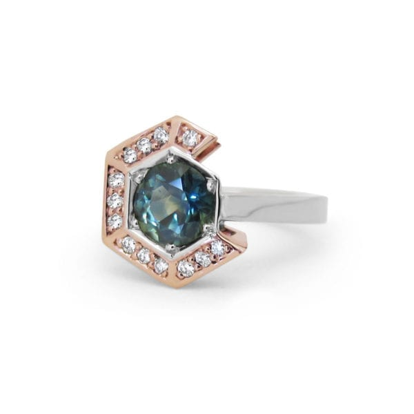 Non traditional engagement ring with blue green sapphire