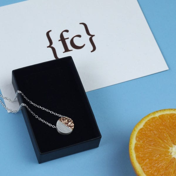 Sterling silver and rose gold disc pendant with orange peel texture