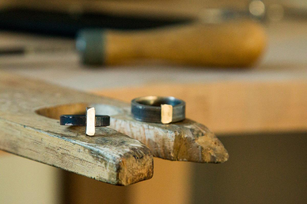 Formed rings with a gold bar running through the middle