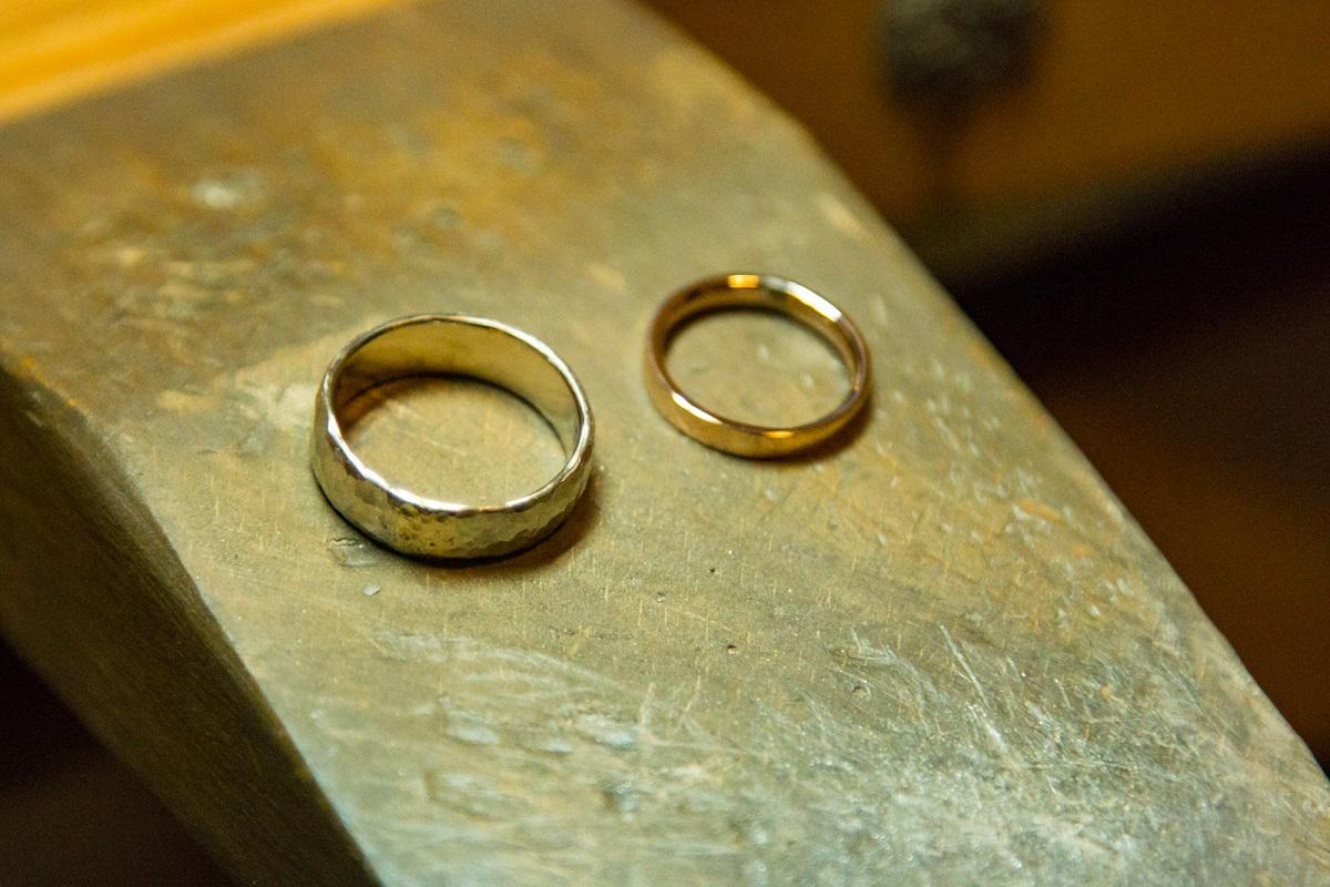 Polished white gold and rose gold wedding rings, side by side