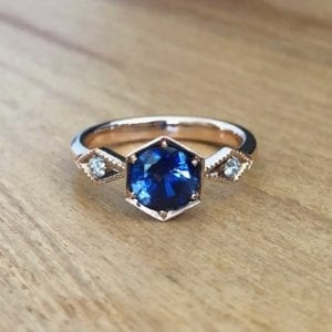 Rose gold, blue sapphire and white diamond vintage engagement ring