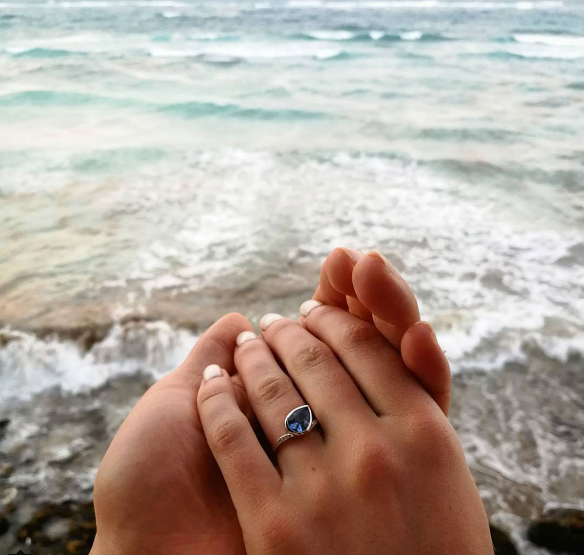 Sapphire ring in a beachside proposal