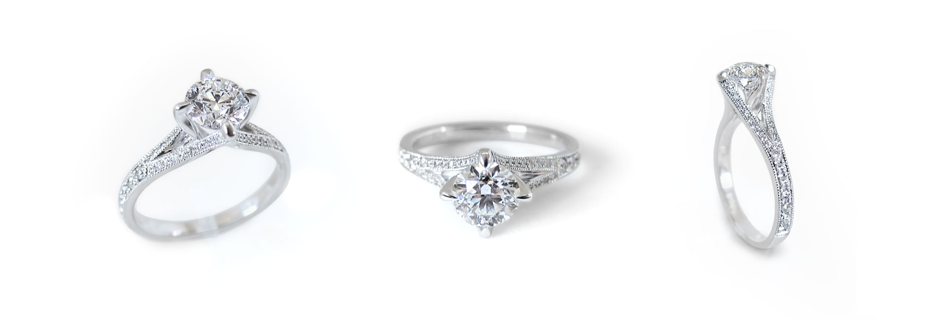 Unique white gold and solitaire diamond engagement ring custom made with a split ring band