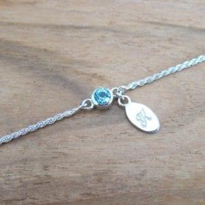 Blue topaz bracelet with monogrammed sterling silver letter tag
