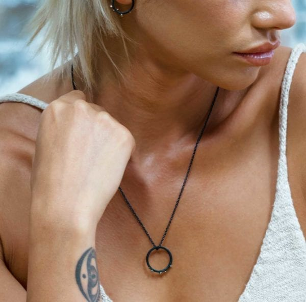 Black and gold silver cable chain necklace with a rustic pendant