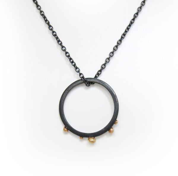 Blackened silver and gold circle necklace