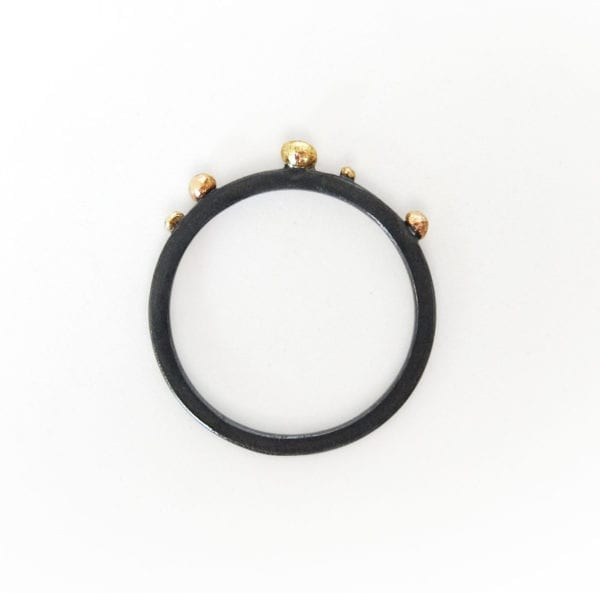 Rustic silver ring in black and gold