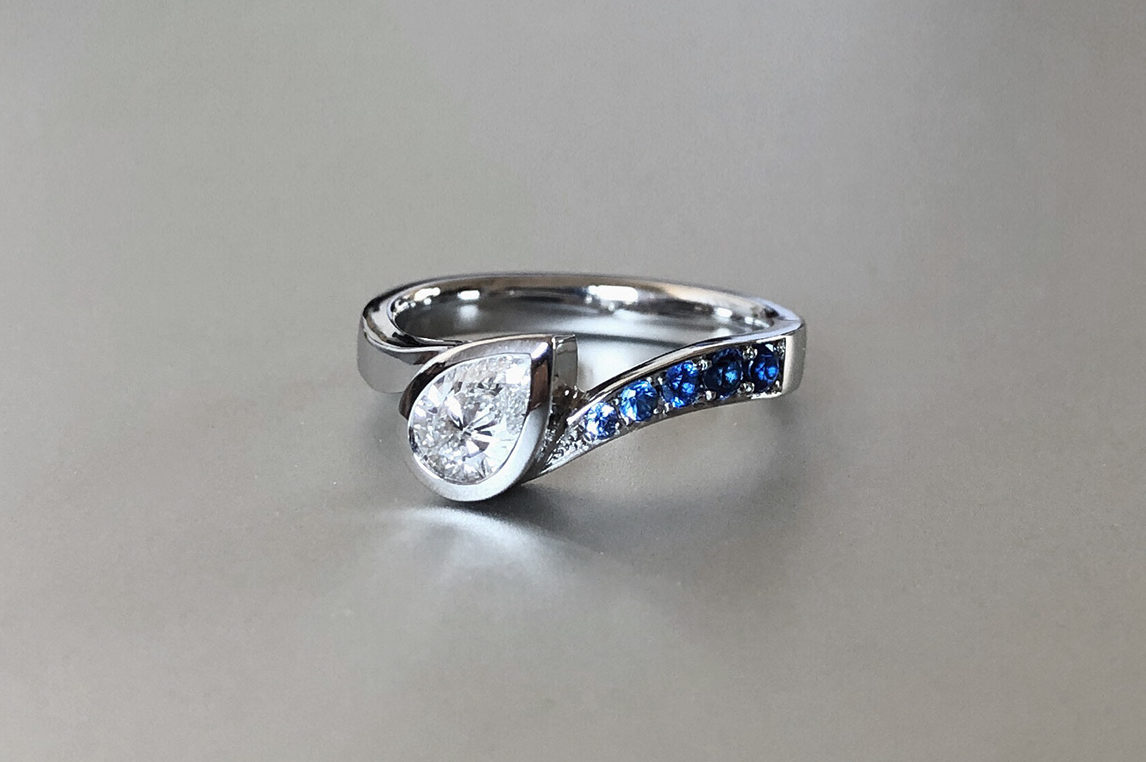 Pear diamond with ombre sapphire in a platinum custom engagement ring