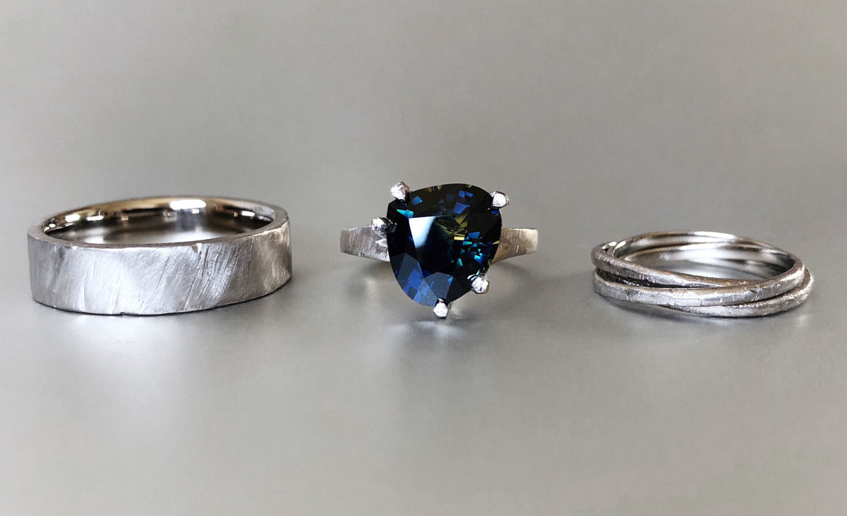 Pear parti sapphire engagement ring and wedding bands
