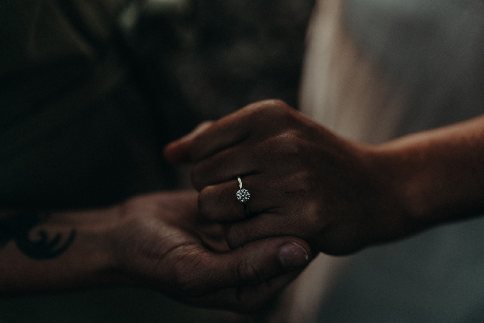 Two women with engagement ring